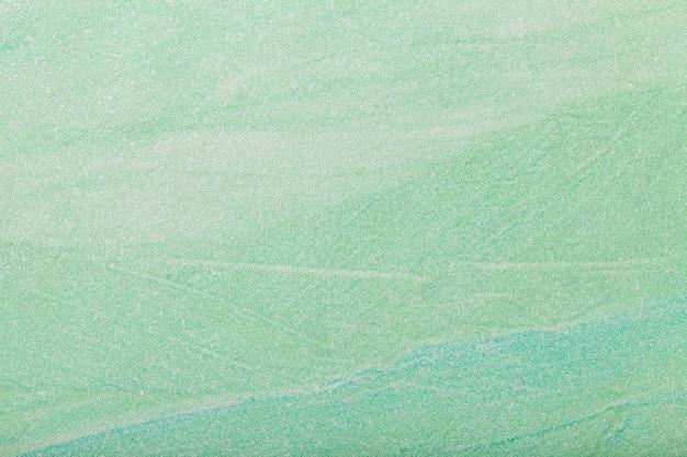 抽象芸術の背景の薄緑色。キャンバスに多色塗装。 Premium写真