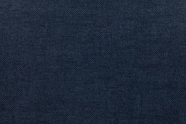 繊維材料からの暗い青色の背景。自然な風合いの生地。背景。 Premium写真