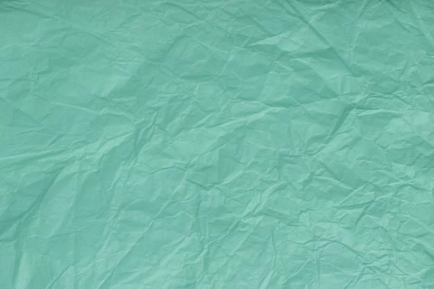 しわくちゃのターコイズ、包装紙、クローズアップのテクスチャ。緑の古い Premium写真