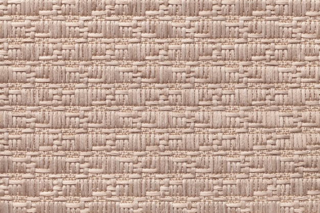 柔らかく毛羽立った布の模様の茶色のニットウール。繊維のクローズアップのテクスチャ。 Premium写真