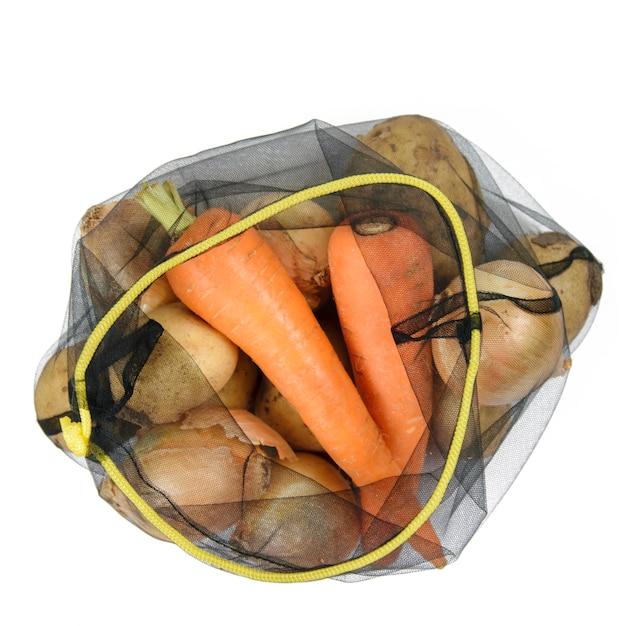 ジャガイモと白のニンジンと食料品のエコバッグ Premium写真