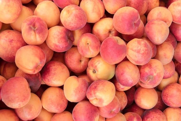 Персики крупным планом Premium Фотографии