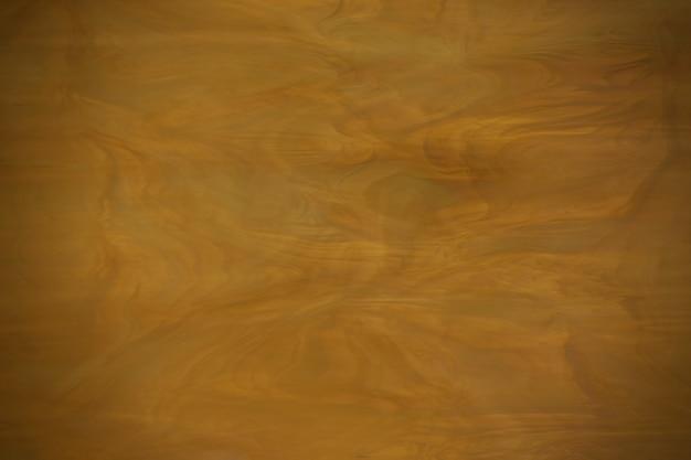 ケラレと黄色の暗いガラスの質感。ソフトぼやけたフォーカス。 Premium写真