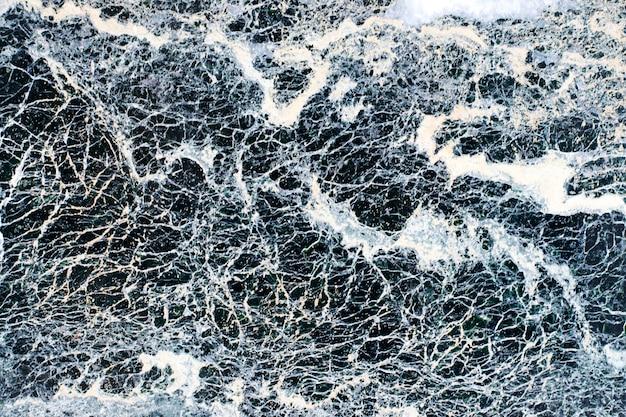 灰色の大理石模様の石のテクスチャ。 Premium写真