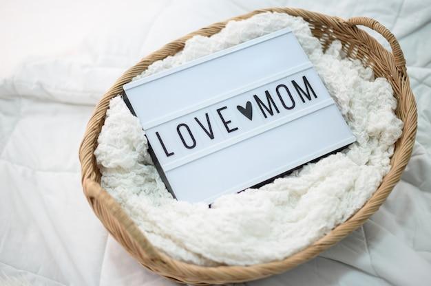生地とママの木製バスケットのサインが大好き 無料写真