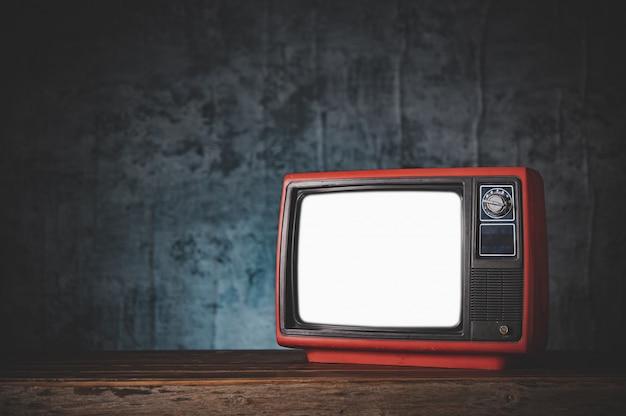 レトロな古い赤いテレビのある静物。 無料写真