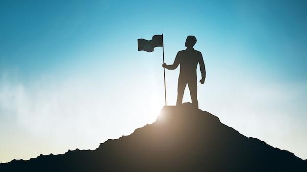 Силуэт человека с флагом на вершине горы над небом Premium Фотографии