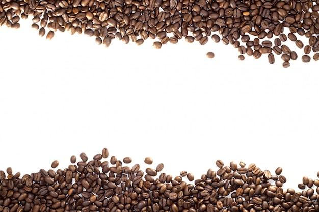 白で隔離されるコーヒー豆フレーム Premium写真