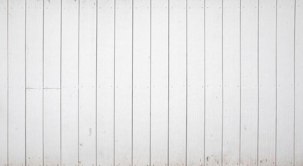 白い木の塀の背景とテクスチャ。 Premium写真