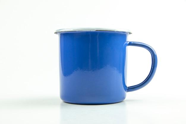 ブルーブリキカップ。 Premium写真