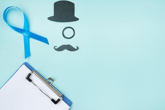 黒い口ひげと青のシルクハットと青いリボン Premium写真