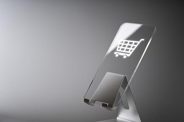 スマートフォンでのオンラインショッピングビジネスアイコンアプリケーション Premium写真