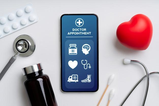 スマートフォン上のオンラインヘルスケアアプリケーション Premium写真