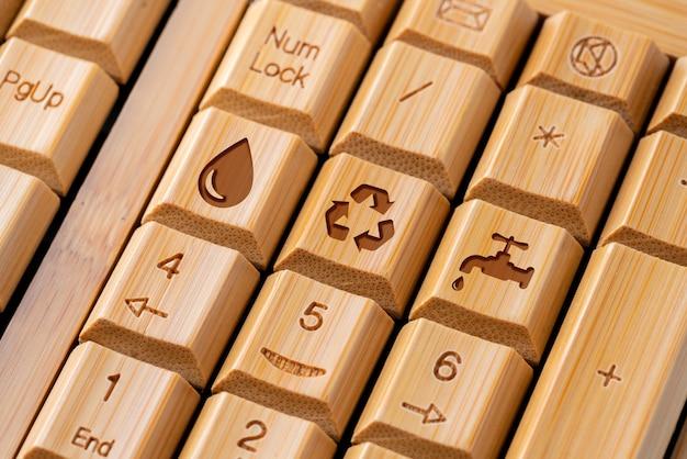 Значок корзины на клавиатуре компьютера для концепции зеленого и эко Premium Фотографии