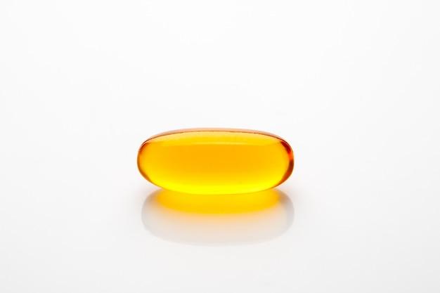 Витаминная капсула рыбий жир для здоровой концепции Premium Фотографии