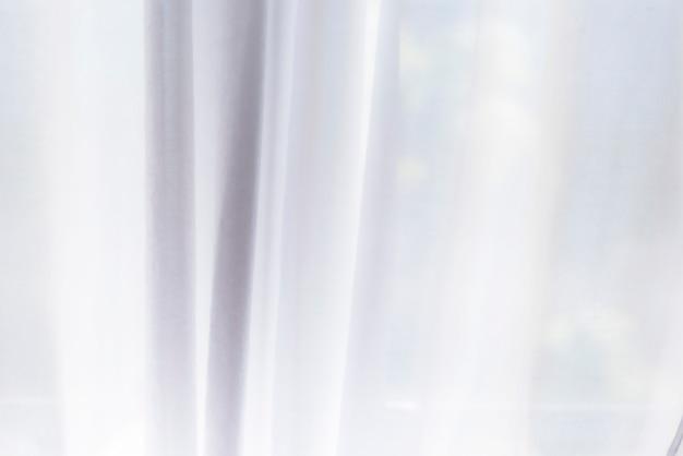 背景またはテクスチャとしての白いカーテン Premium写真