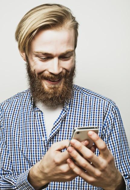 若者を生やした携帯電話 Premium写真