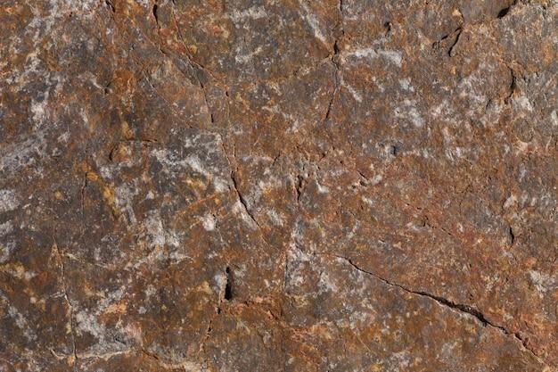 Каменная текстура с прожилками. задний план Premium Фотографии