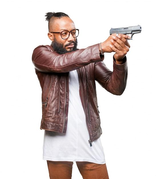 Человек, указывая с ружьем Бесплатные Фотографии