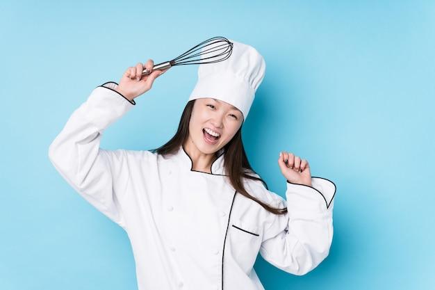 Молодая японская женщина шеф-повар Premium Фотографии