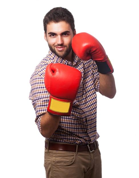 ボクシンググローブとチェック柄のシャツの男 無料写真