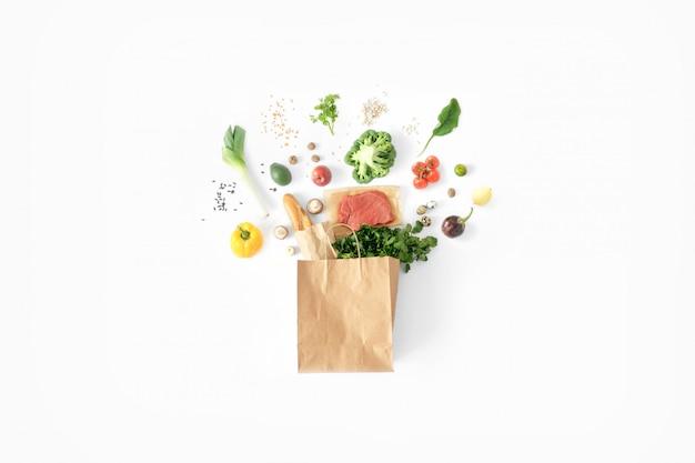 Полный бумажный пакет здоровой пищи белый здоровое питание фон Premium Фотографии