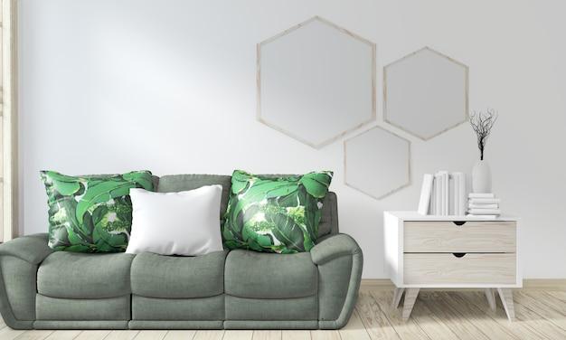 ソファグリーンと装飾植物のあるポスターフレームルームのモックアップ Premium写真