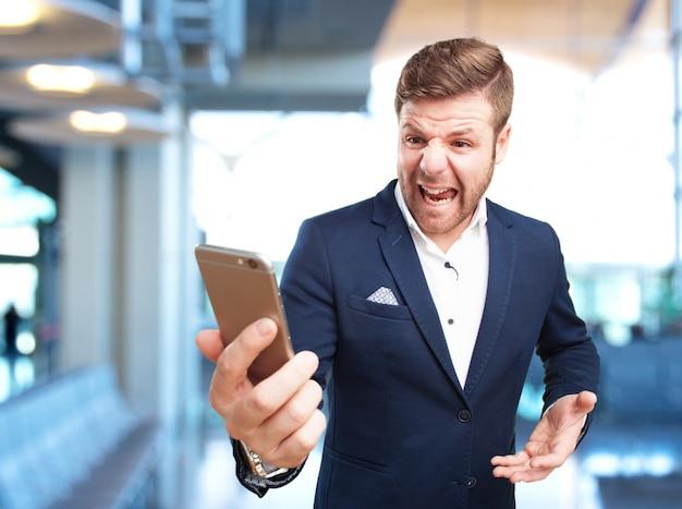 Молодой предприниматель, злое выражение Бесплатные Фотографии