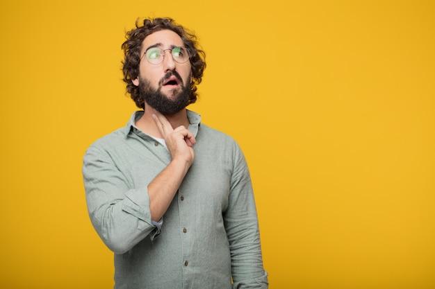 コンセプトを表現している若いひげのあるビジネスマン Premium写真