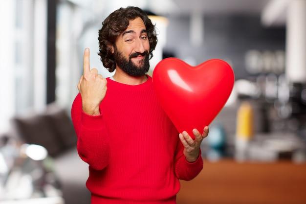 恋、バレンタインデーのコンセプトで狂った若者。 Premium写真