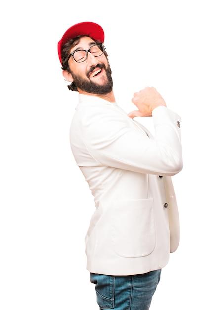 若いクレイジービジネスマンは誇らしげなポーズ 無料写真