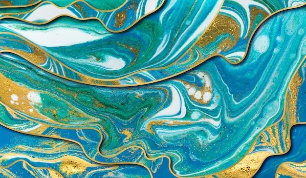 緑、青、金の波紋の背景。レイヤーを持つ大理石のテクスチャ。金粒子。 Premium写真