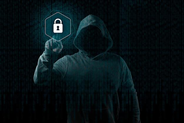 抽象的なデジタル背景の上の匿名のコンピューターハッカー。マスクとフードの中の隠れた暗い顔。 Premium写真