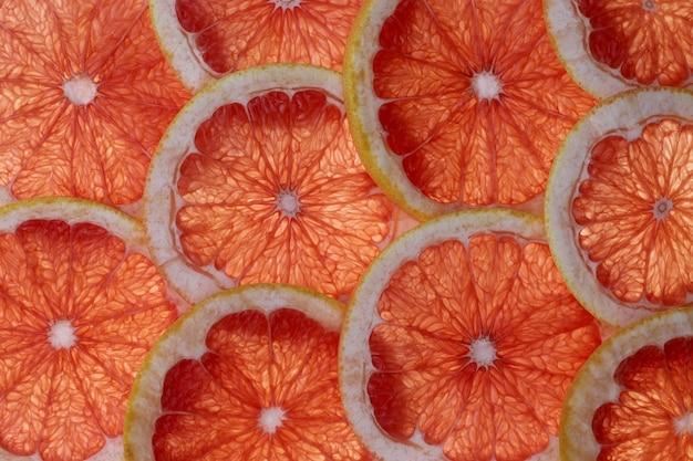グレープフルーツのスライスの抽象的な背景 Premium写真