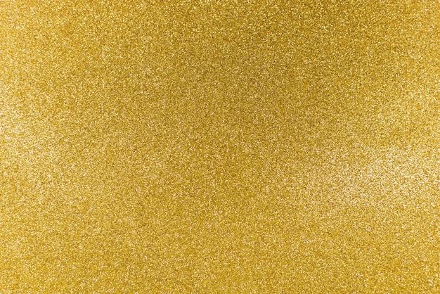 黄金の光沢のあるゴールドキラキラテクスチャクリスマス抽象的な背景。 Premium写真