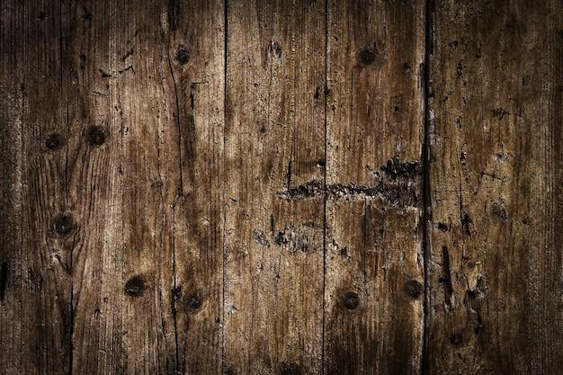 美しい古いアンティークダークウッドテクスチャ表面の背景の背景。スペースをコピーします。 無料写真