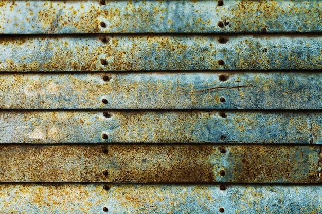 グランジラスティストライプスウォールの美しいテクスチャ。水平。パターン。緑色の背景。ブルーターコイズブルー。 無料写真