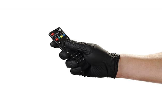 Жест рукой показывает, хорошая реклама для охранного агентства. держит пульт от телевизора. Premium Фотографии
