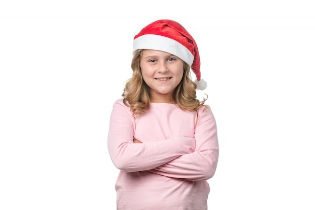 赤いサンタ帽子の少女 Premium写真