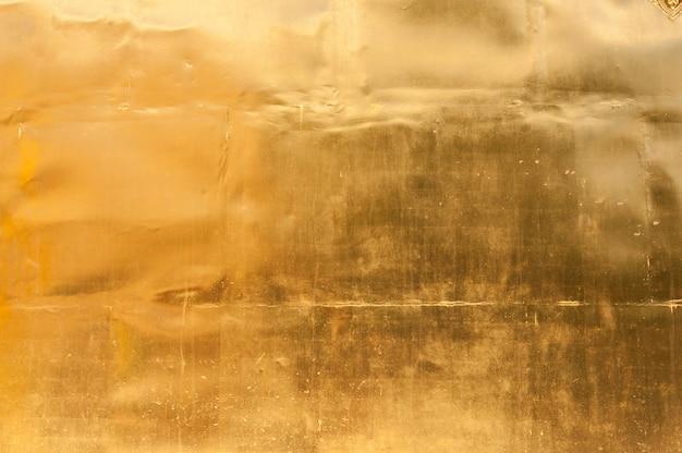 Золотая стена текстура фон Premium Фотографии