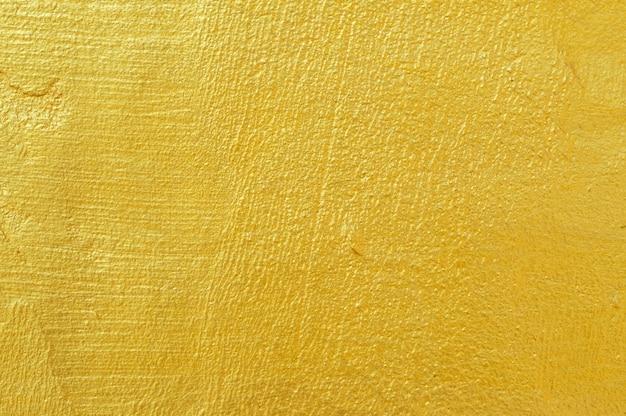 金色の壁の背景テクスチャ Premium写真