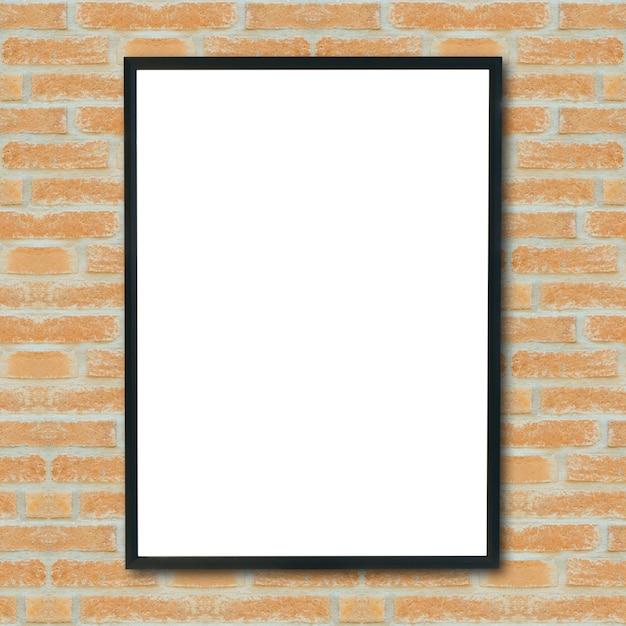レンガの壁に空のポスターの額縁をモックアップします。 無料写真
