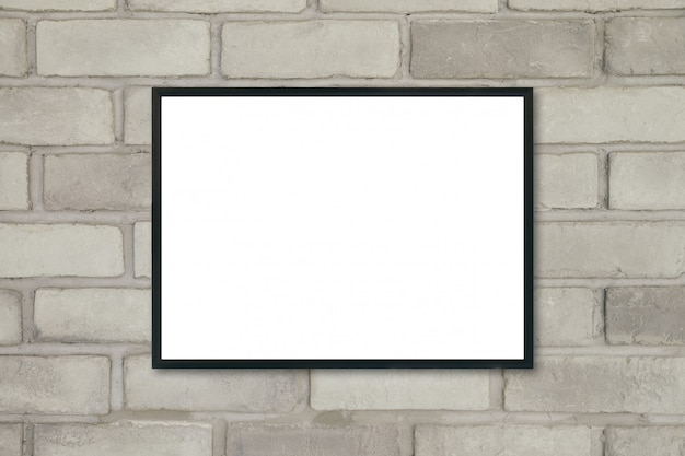 Макет пустой плакат фоторамка на кирпичной стене. Premium Фотографии