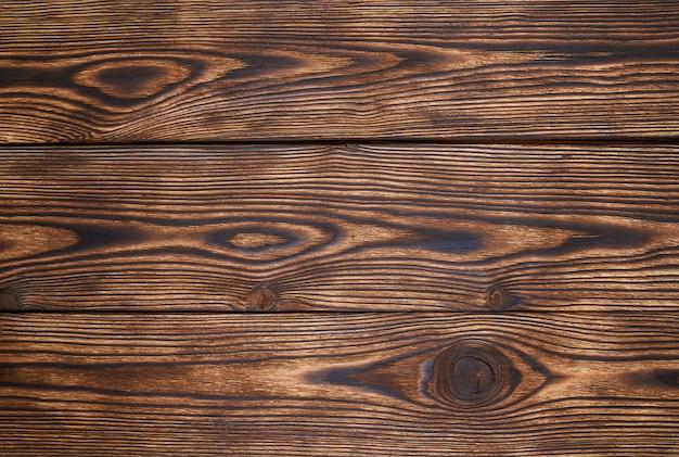 木製の板は、美しいパターンと背景のテクスチャを茶色します。木製の背景 Premium写真