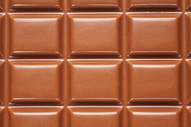 チョコレートバーから背景をクローズアップ。 Premium写真