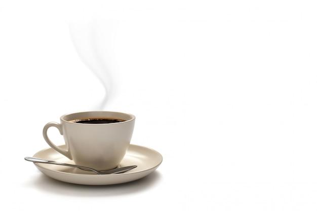 白で隔離される煙でコーヒーカップ Premium写真