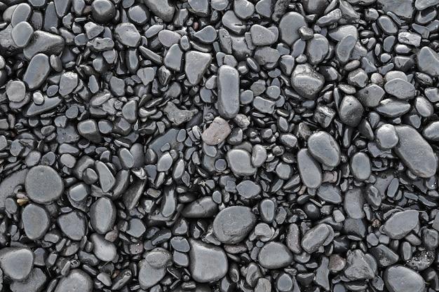 ぬれた黒い小石の背景 Premium写真