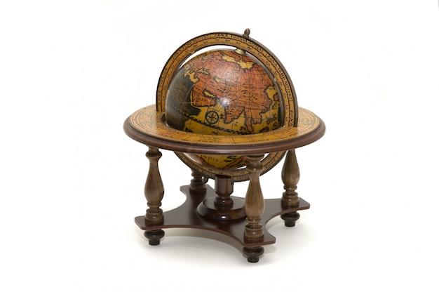 Античный земной шар на белом Premium Фотографии