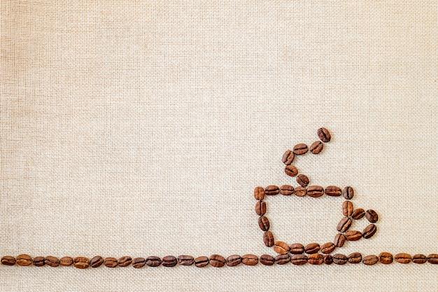 キャンバスとコーヒー豆が引き分け Premium写真