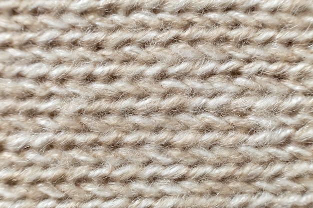 グレーベージュリネンキャンバスの表面の背景。荒布デザイン、生態学的な綿織物、ファッショナブルな織りフレックス黄麻布。 Premium写真